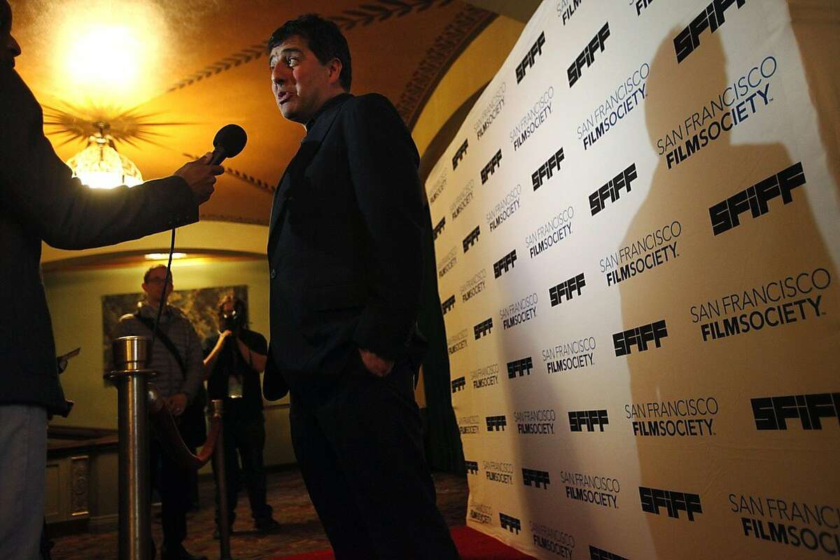 Hossein Amini, Director of the opening night film, The Two Faces of January, responds to interview questions on the red carpet during the opening night of the San Francisco International Film Festival April 24, 2014 at the Castro Theatre in San Francisco, Calif.