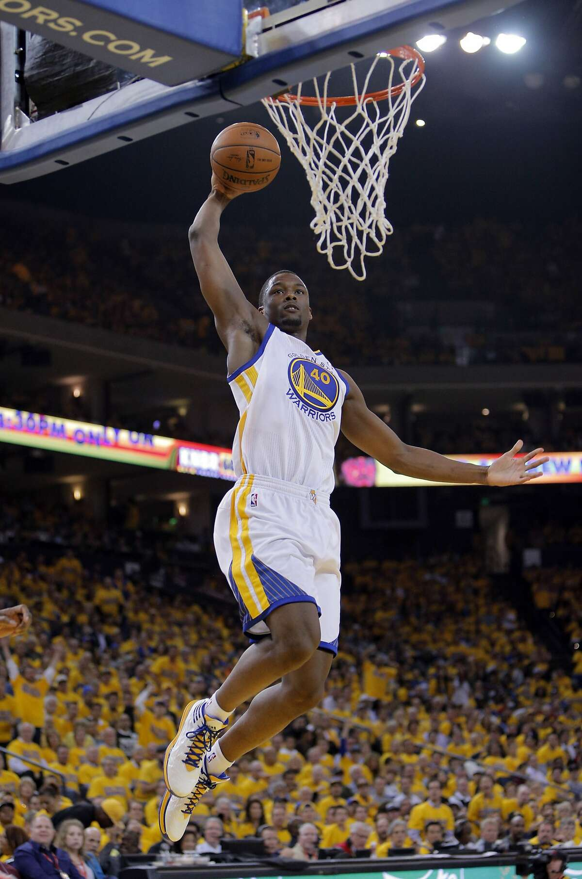 Harrison Barnes (40) dunks the ball in the first half. The Golden State Warriors played the Los Angeles Clippers at Oracle Arena in Oakland, Calif., on Thursday, April 24, 2014, in Game 3 of the first-round playoff series.