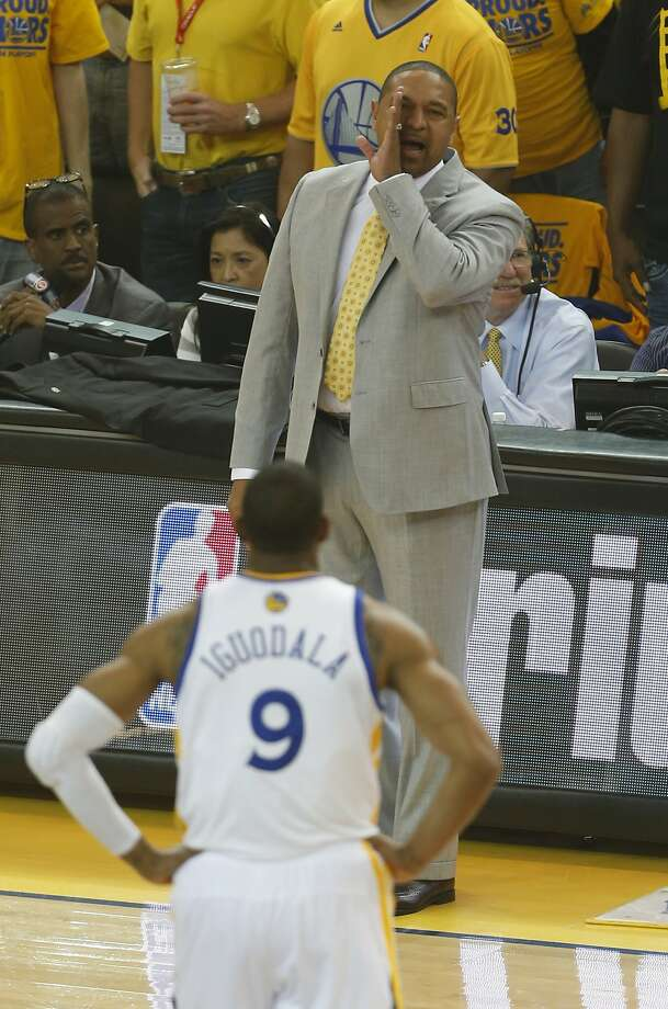 Warriors head coach Mark Jackson talks to guard Andre Iguodala (9) during the first half  of Game 3 of the first round playoff series against the Clippers on Thursday, April 24, 2014 in Oakland, Calif. Photo: Beck Diefenbach, Special To The Chronicle