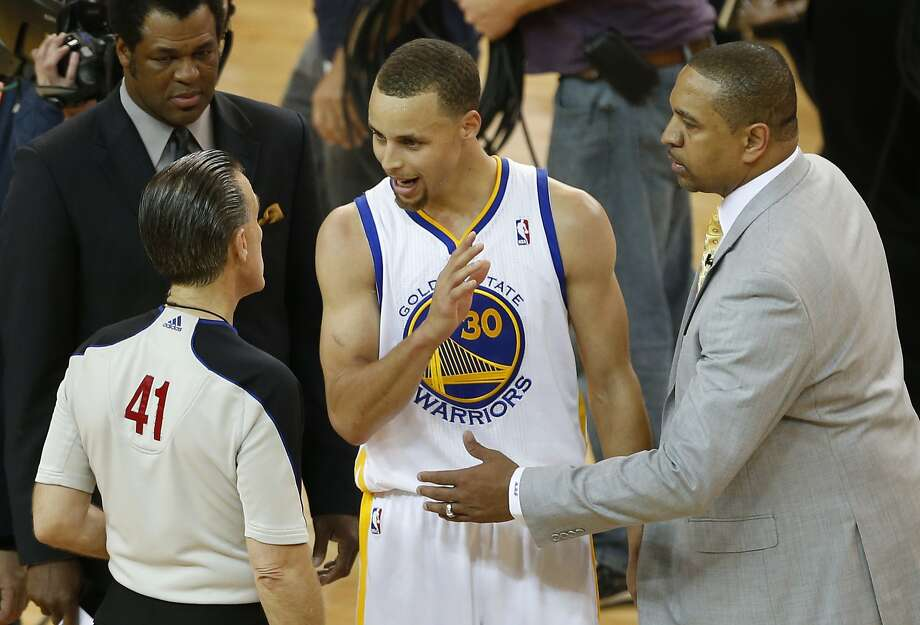 Stephen Curry makes his case with referee Ken Mauer for a foul call on his final shot in the Warriors' Game 3 loss. Photo: Beck Diefenbach, Special To The Chronicle