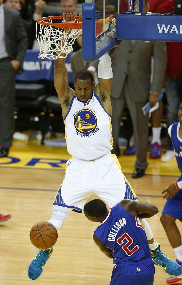 Andre Iguodala dunks over Darren Collison in the second half of Game 3. It was the Warrior's best game so far in the series: 11 points and nine rebounds. Photo: Beck Diefenbach, Special To The Chronicle