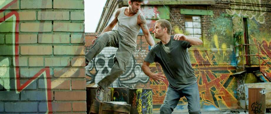 David Belle and Paul Walker star in Relativity Media's BRICK MANSIONS. Photo: Philippe Bosse, Relativity Media