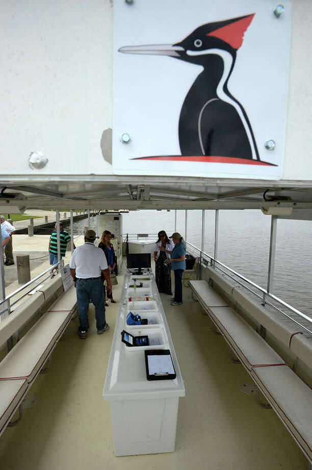 Guests board the Ivory Bill at the Neches River Park in Beaumont on Thursday. The 40-foot pontoon boat will be used to provide tours through the Big Thicket in the Pine Island Bayou-Neches River area.  Photo taken Thursday, April 24, 2014 Guiseppe Barranco/@spotnewsshooter Photo: Guiseppe Barranco, Photo Editor