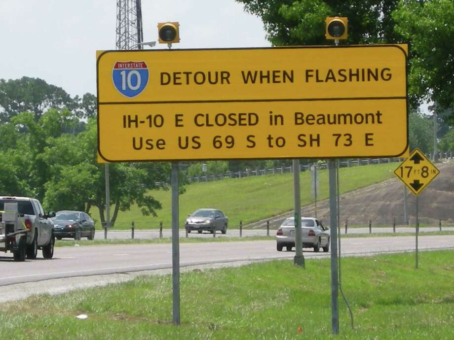 New signs that went up Friday point motorists to detours when sections of Interstate 10 might be closed. One sign is on Eastex Freeway near Delaware Street. Another is on U.S. 90 near Major Drive. Other signs will be in Chambers and Orange counties. Courtesy photos, Texas Department of Transportation. Photo: TxDOT
