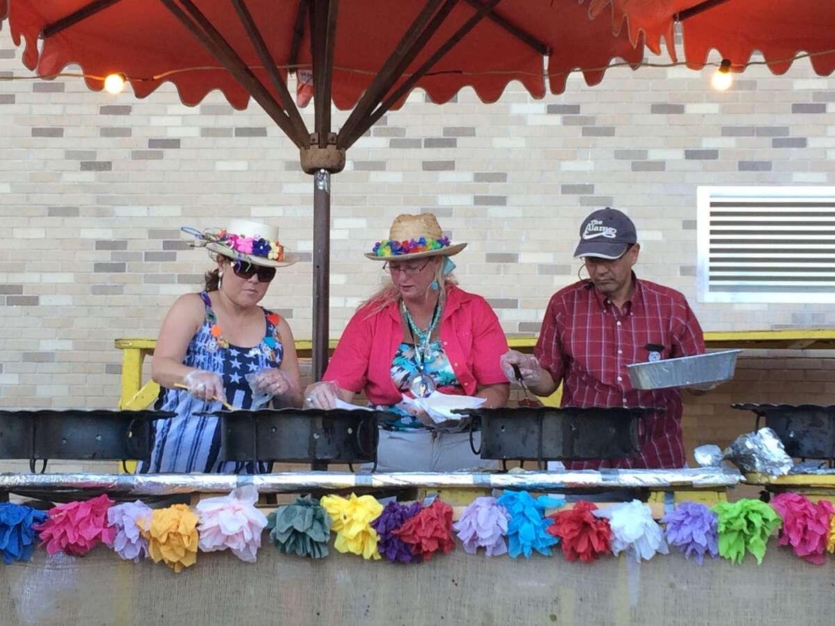 Volunteers cook Maria's Tortillas at NIOSA Thursday night.
