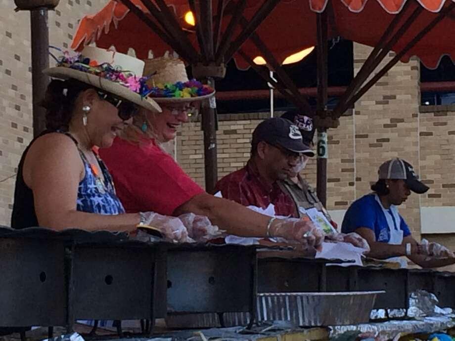 Volunteers cook Maria's Tortillas at NIOSA Thursday night. Photo: Benjamin Olivo, MySA.com