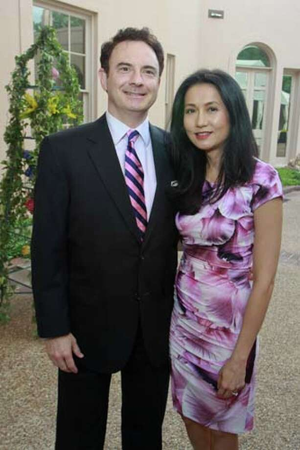 Scott and Thi Crist at the 2014 Rienzi Spring Party. Photo: Gary Fountain, For The Chronicle / Copyright 2014 by Gary Fountain