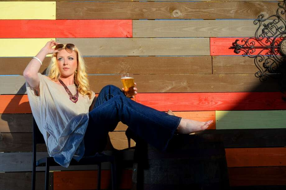 Model Kristen Campbell on Madison's Patio. Photo taken Tuesday, April 15, 2014 Guiseppe Barranco/@spotnewsshooter