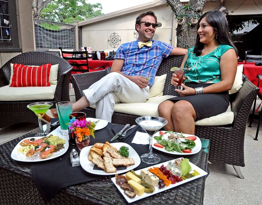 Nathaniel Welch, left, and Meg Baertl, right, sit down over drinks and eats on the patio at The Grill in Beaumont on Wednesday, May 15, 2013.  Photo taken: Randy Edwards/The Enterprise