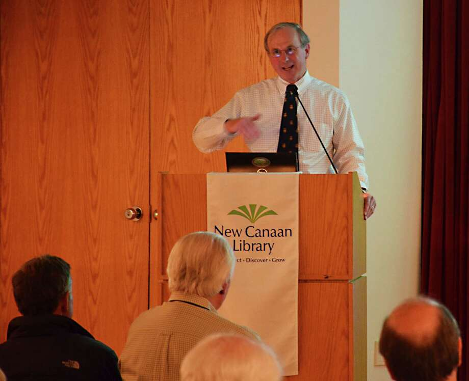 "Geologist and conservationist G. Warfield ìSkipî Hobbs speaks about ""The Future of Planet Earth"" at the New Canaan Library, in New Canaan, Conn., on Wednesday, April 23, 2014. Photo: Nelson Oliveira / New Canaan News"