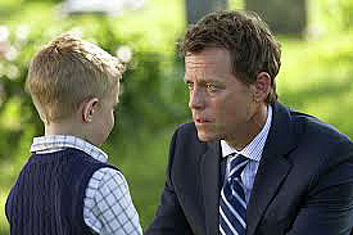Greg Kinnear, right, portrays a Nebraska minister in the new movie,