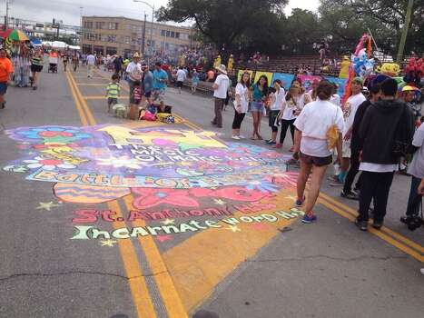Revelers and participants await the start of the Battle of Flowers Parade on Friday, April 25, 2014. Photo: Michelle Casady, San Antonio Express-News
