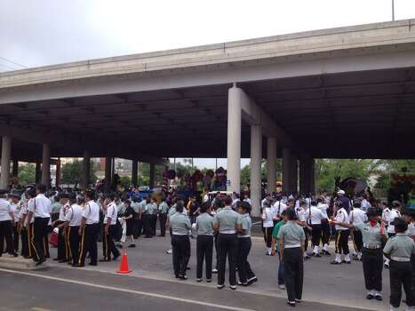 JROTC groups await the start of the Battle of Flowers Parade on Friday, April 25, 2014. Photo: Michelle Casady, San Antonio Express-News