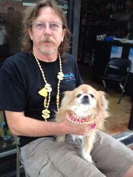 Chris and his dog Ginger (sporting recycled Mardi Gras beads) await the start of the Battle of Flowers Parade on Friday, April 25, 2014. Photo: Michelle Casady, San Antonio Express-News