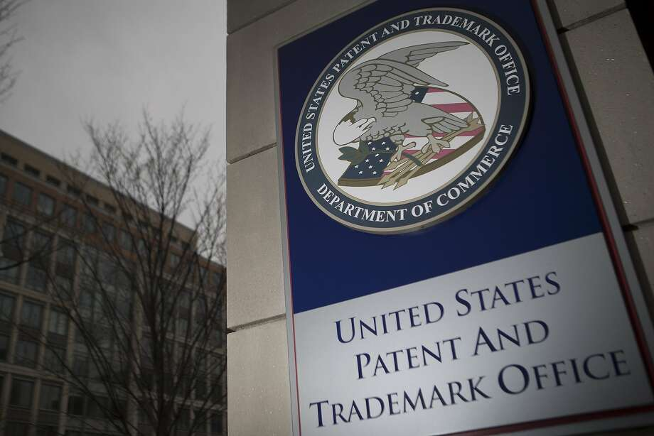 The U.S. Patent and Trademark Office (USPTO) seal is displayed outside the headquarters in Alexandria, Virginia, U.S., on Friday, April 4, 2014. The Senate Judiciary Committee tomorrow plans to mark up a measure that would curb the activities of so-called patent trolls after pulling back the bill last week in the face of opposition from such companies as 3M Co., AstraZeneca Plc, Monsanto Co. and Procter & Gamble Co. Photographer: Andrew Harrer/Bloomberg Photo: Andrew Harrer, Bloomberg