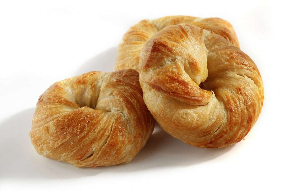 """Jenny Puente, co-owner of House of Bagels, admits New York pastry chef Dominique Ansel inspired her to concoct the """"cragel"""" ($2.95), layers of croissant and bagel dough twisted around each other and boiled. Photo: Craig Lee, Special To The Chronicle"""