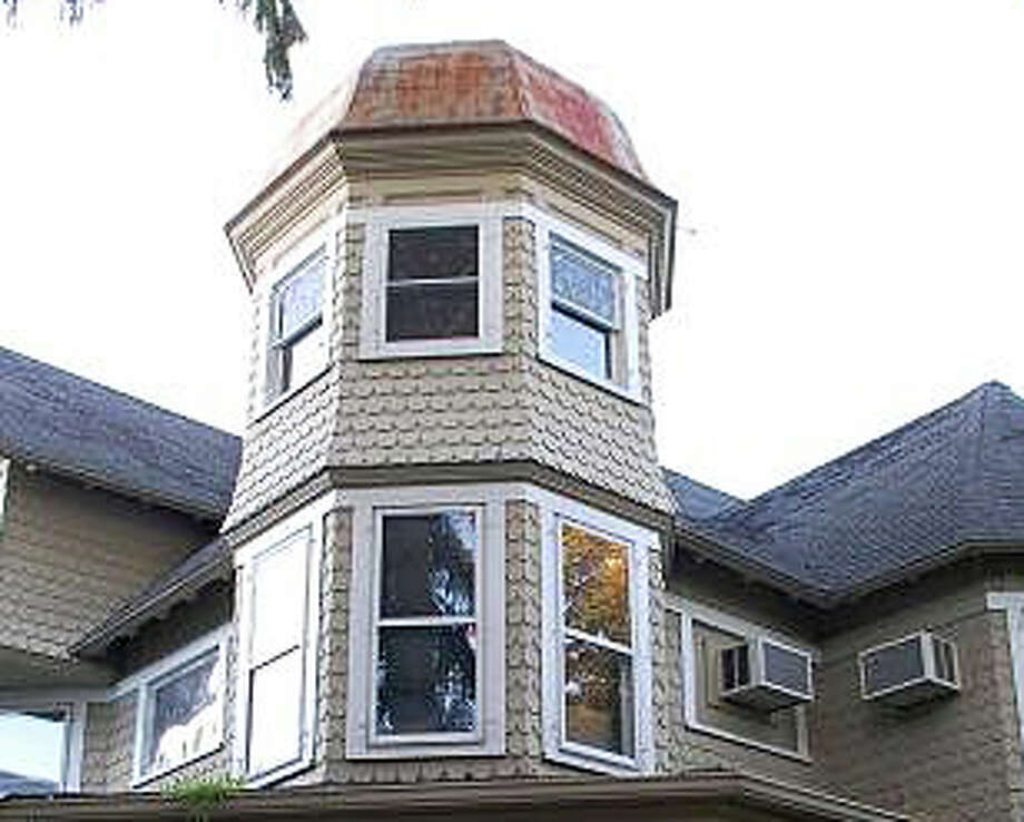 "Is it a ""dome"" or an architectural feature consistent with Queen Anne-style houses? The bate over that feature and how it would affect the height of a relocated Kemper-Gunn House caused the Planning and Zoning Commission to delay a vote on the proposal. Photo: File Photo / Westport News"