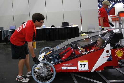The driver of the gasoline-powered Trident #77 Prototype,  competing for the Ruston High School team from Louisiana, goes through technical inspection at the Shell Eco-marathon in downtown Houston in April 2014. Photo: Aaron M. Sprecher, Associated Press