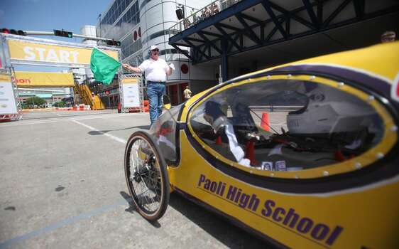 A prototype vehicle starts its laps around the track at Discovery Green park in downtown Houston during the 2012 Shell Eco-marathon Americas.  High school and college students test vehicles they have designed and built to see which can go the farthest distance using the least amount of fuel. Photo: Mayra Beltran, Houston Chronicle