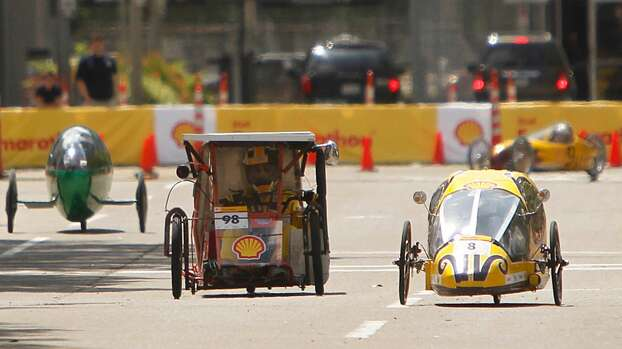 San Antonio's James Madison High School prototype vehicle circles the track around Discovery Green in downtown Houston during the 2012 Shell Eco-marathon Americas. High school and college students test vehicles they have designed and built to see which can go the farthest distance using the least amount of fuel. Photo: Mayra Beltran, Houston Chronicle