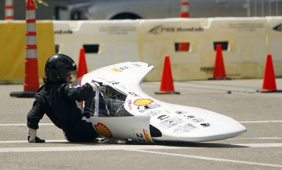 Driver Teresa Ponte, of Mexico's UNAM, crashes on the track during the 2012 Shell Eco-Marathon Americas. High school and college students test vehicles they have designed and built to see which can go the farthest distance using the least amount of fuel. Photo: Mayra Beltran, Houston Chronicle