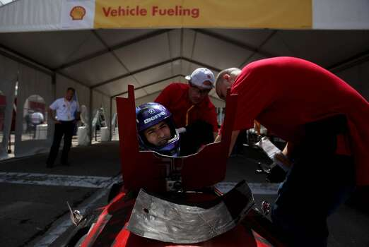Driver Edwin Rendon, of the University of Houston team, gets ready to ride the track around Discovery Green in downtown Houston during the 2012 Shell Eco-Marathon Americas competition. High school and college students test vehicles they have designed and built to see which can go the farthest distance using the least amount of fuel. Photo: Mayra Beltran, Houston Chronicle