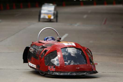 Driver Edwin Rendon, of the University of Houston team, drives the track around Discovery Green in downtown Houston during the Shell Eco-marathon Americas competition. High school and college students test vehicles they have designed and built to see which can go the farthest distance using the least amount of fuel. Photo: Mayra Beltran, Houston Chronicle