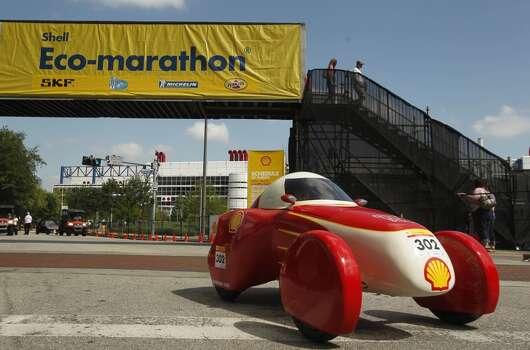 The UrbanConcept Vehicle drives the track around Discovery Green in downtown Houston during the 2012 Shell Eco-marathon Americas. High school and college students test vehicles they have designed and built to see which can go the farthest distance using the least amount of fuel. Photo: Mayra Beltran, Houston Chronicle