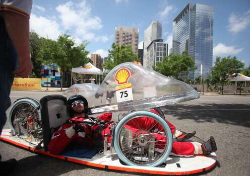 Ethan Skinner, 18, of Indiana's Rose-Holman College, has to stop during his laps due to technical difficulties during the 2012 Shell Eco-Marathon Americas in downtown Houston. High school and college students test vehicles they have designed and built to see which can go the farthest distance using the least amount of fuel. Photo: Mayra Beltran, Houston Chronicle