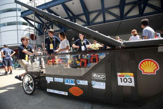 The Rice University team pushes their solar-powered prototype vehicle to participate in the 2012 Shell Eco-marathon Americas. High school and college students test vehicles they have designed and built to see which can go the farthest distance using the least amount of fuel. Photo: Mayra Beltran, Houston Chronicle