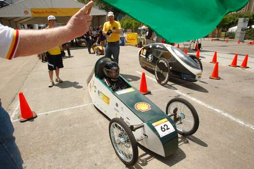 Drivers start their laps during the 2012 Shell Eco-Marathon Americas in downtown Houston. High school and college students test vehicles they have designed and built to see which can go the farthest distance using the least amount of fuel. Photo: Mayra Beltran, Houston Chronicle