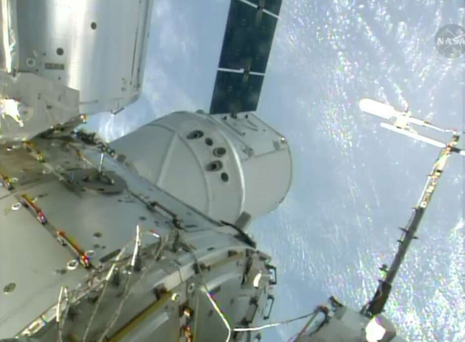 In this Sunday, April 20, 2014, image made from a frame grabbed from NASA-TV, the SpaceX Dragon resupply capsule is seen after being berthed on to the International Space Station. At the time of this frame grab the capsule was traveling over Brazil at 10:14 a.m. EDT Sunday. (AP Photo/NASA-TV) Photo: Associated Press
