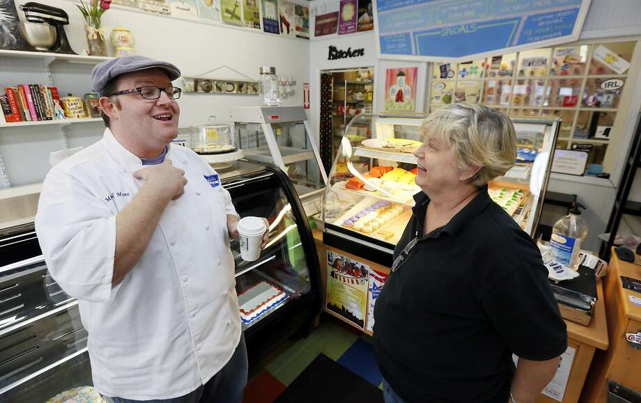 Mitchell Moore, a baker, left, talks with Tina Fortenberry in his Jackson, Miss., store. Moore wants to demonstrate support for gay and lesbian customers. Photo: Rogelio V. Solis, Associated Press