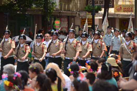 The Thomas Edison High School Junior ROTC marches during the Battle of Flowers parade on Friday, April 25, 2014. Photo: Billy Calzada, San Antonio Express-News