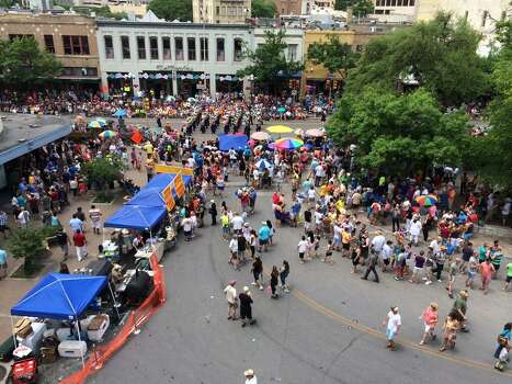 The Battle of Flowers parade is seen from the third floor balcony at the Menger Hotel on Friday, April 25, 2014. Photo: Kolten Parker, San Antonio Express-News