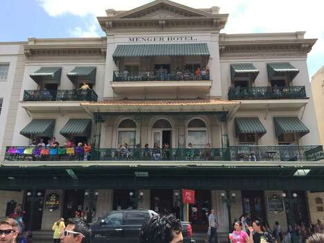 Parade goers watch Battle of Flowers from the balconies of the Menger Hotel on Friday, April 25, 2014. Photo: Kolten Parker, San Antonio Express-News