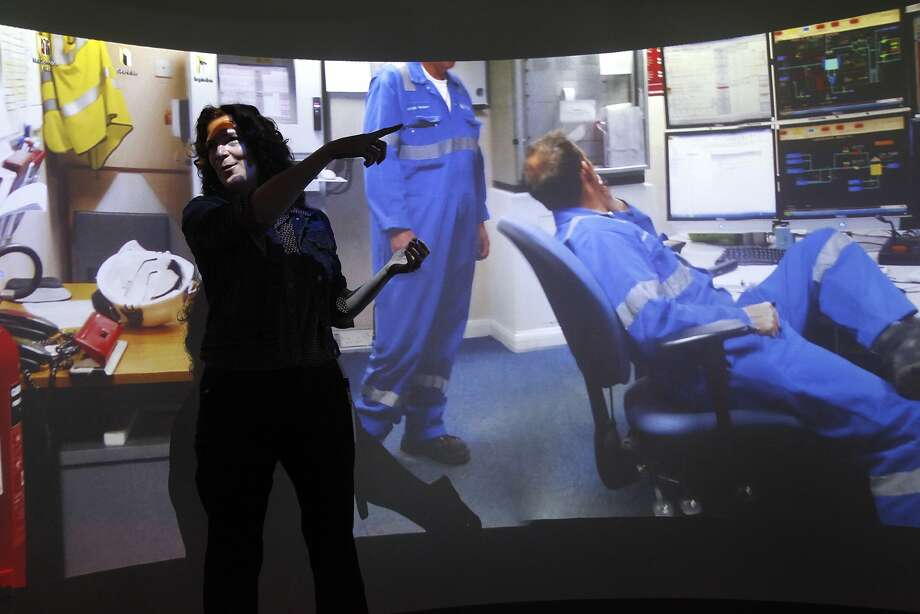 "General Electric's Samantha Soma shows off the company's ""holodeck"" at its San Ramon design center. Photo: Leah Millis, San Francisco Chronicle"