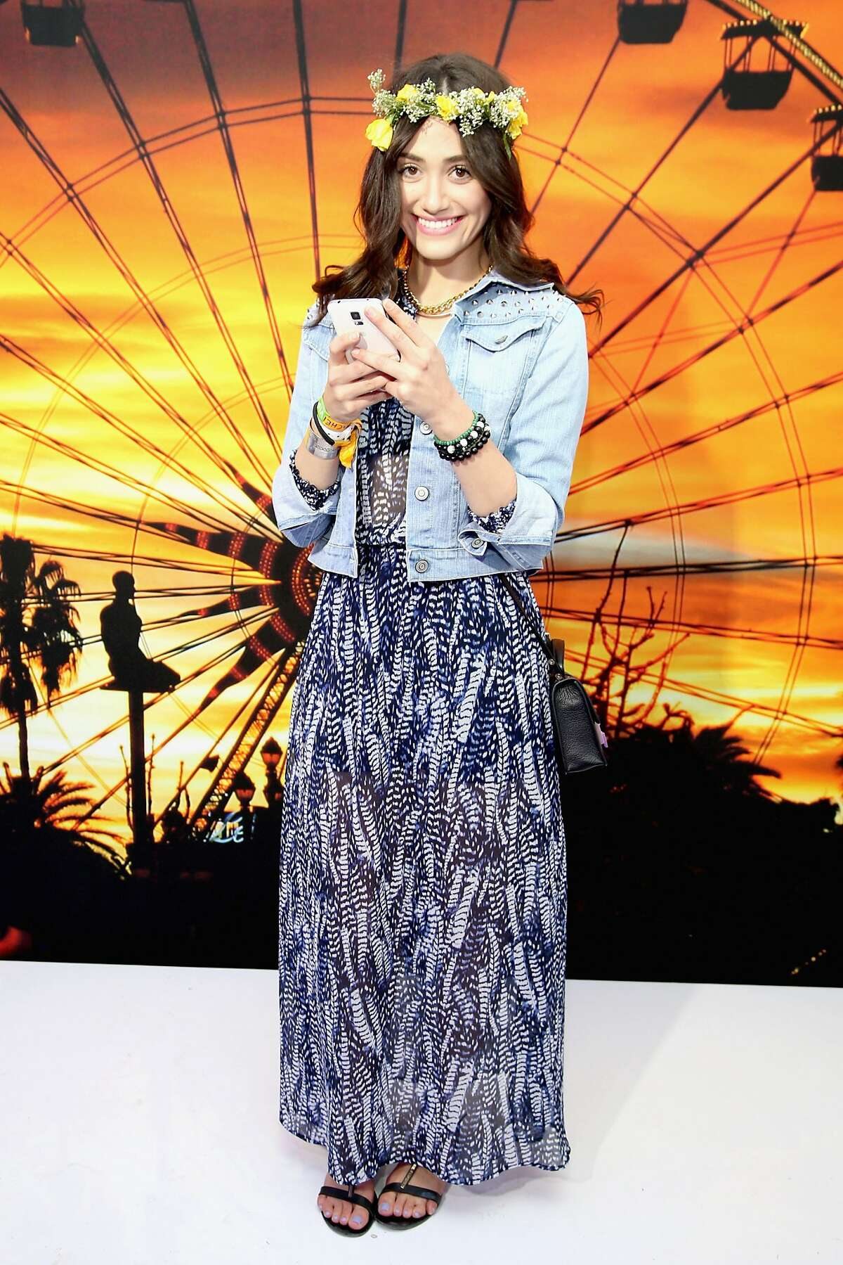 In case you missed it, we poked fun at a few of the style trends dominating Coachella 2014. Click through the gallery to see some of the elements that define today's festival fashion for better or worse. Pictured: Actress Emily Rossum, in garland and jean jacket, at Coachella in April.