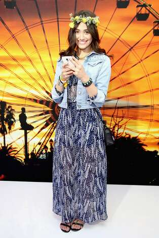 In case you missed it, we poked fun at a few of the style trends dominating Coachella 2014. Click through the gallery to see some of the elements that define today's festival fashion for better or worse. Pictured: Actress Emily Rossum, in garland and jean jacket, at Coachella in April. Photo: Jonathan Leibson / Getty, Getty Images For Samsung