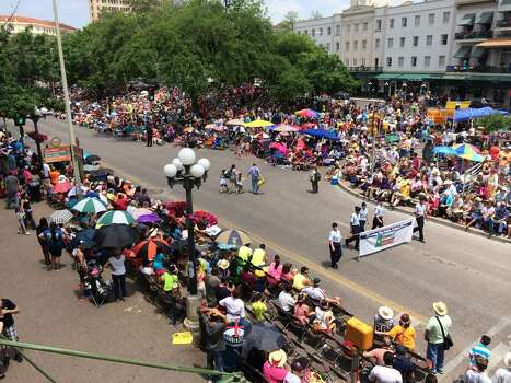 Battle of Flowers makes its way through Alamo Plaza, as seen from the Pat O'Brien's balcony, on Friday, April 25, 2014. Photo: Kolten Parker, San Antonio Express-News