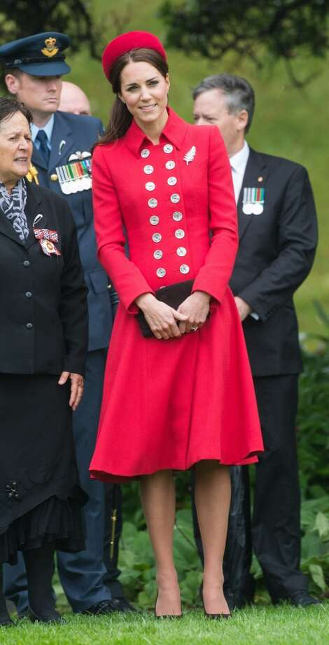 Kate Middleton stands out in red at a Ceremonial Welcome at Government House on April 7, 2014 in Wellington, New Zealand. Photo: Samir Hussein, WireImage
