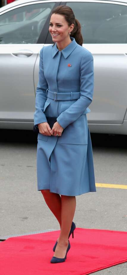 Buckled up in a long, blue coat Catherine, Duchess of Cambridge smiles as she meets the gathered crowds in Seymour Square during the Royal Tour to New Zealand on April 10, 2014 in Blenheim, New Zealand. Photo: Chris Jackson, Getty Images