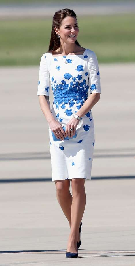 Pretty poppies. Catherine, Duchess of Cambridge, in a white dress with a blue floral print, arrives at the Royal Australian Airforce Base at Amberley on April 19, 2014 in Brisbane, Australia. Photo: Chris Jackson, Getty Images