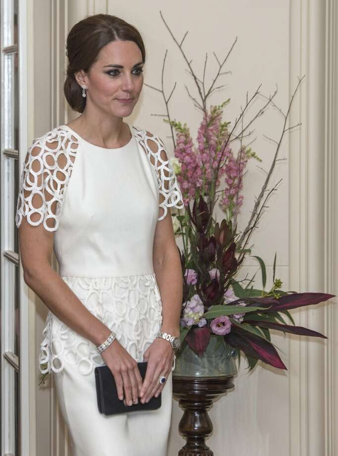 Middleton's updo is a nice touch with her Lela Rose dress she wore during a reception hosted by the Governor General Peter Cosgrove and Her excellency Lady Cosgrove at Government House on April 24, 2014 in Canberra, Australia. The lace sleeves and trim around the waist are perfect. Photo: Getty Images
