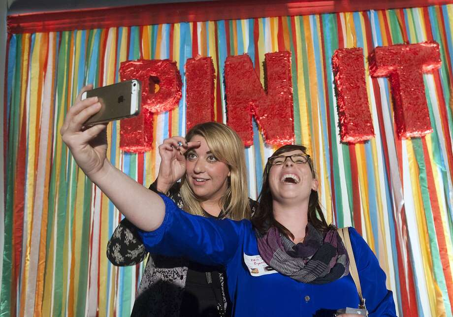 Kris Israel (right) takes a selfie with Kate Miano at the Pinterest event in San Francisco. Photo: Josh Edelson, AFP/Getty Images