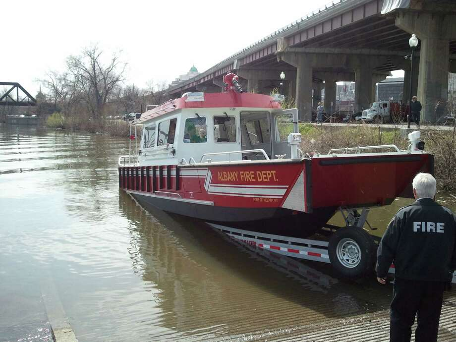The Albany Fire Department's new fireboat heads into the Hudson River on Friday, April 25, 2014, from the Corning Preserve launch. (Brian Nearing/Times Union)