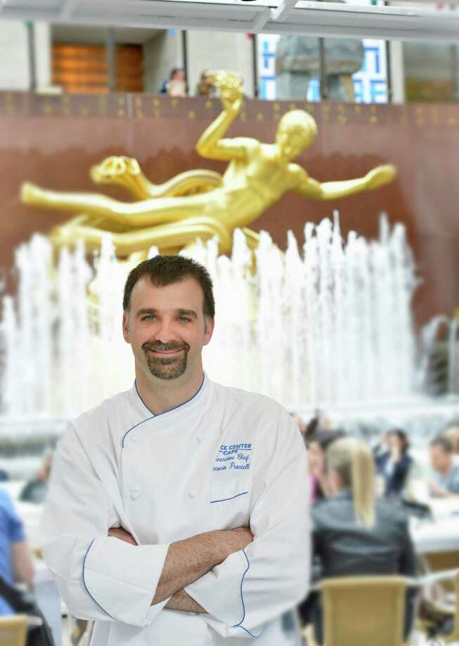 New Milford resident Anthony Prontelli is executive chef at Manhattanís Rock Center Café, the well-known restaurant which overlooks the ice skating rink at Rockefeller Center. He's also started a new business, Mesa Concepts, which designs kitchens for businesses and private homes. Photo: Contributed Photo / The News-Times Contributed
