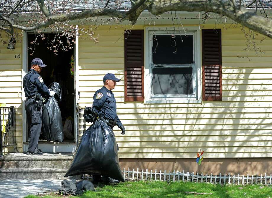 Police officers remove bags filed with items taken from the scene at 10 Eleanor Road in Seymour, Conn. on Friday, April, 25, 2014. Arthur Gauvin was arrested after his sister Nancy was found being held in the house. Photo: Cathy Zuraw / Connecticut Post