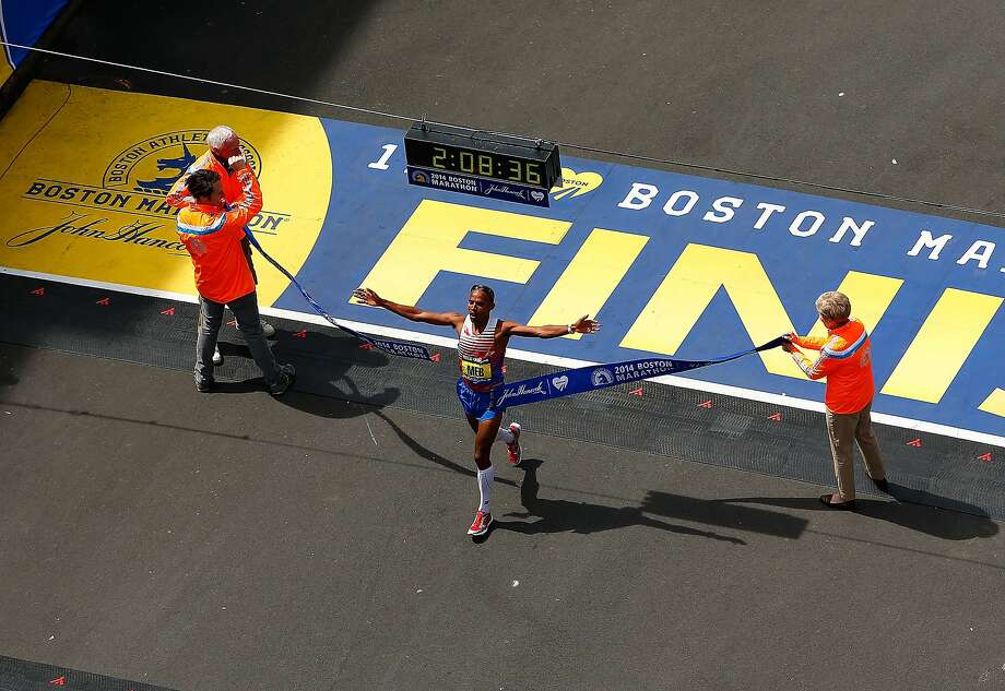 Meb Keflezighi crosses the finish line at the Boston Marathon last week, the first American winner since 1983. He wore Skechers shoes, below. Photo: Jared Wickerham, Getty Images