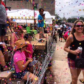 A little girl ambushes passersby with confetti during Battle of Flowers on Friday, April 25, 2014. Photo: Benjamin Olivo, San Antonio Express-News